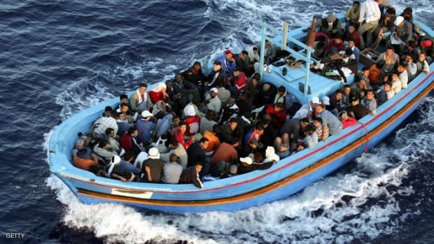 A boat loaded with illegal immigrant. (Photo by Marco Di Lauro/Getty Images)