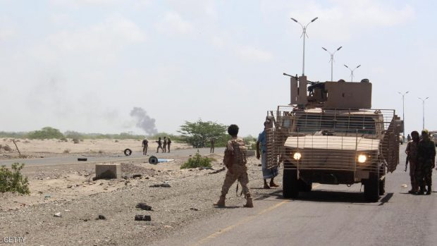 Forces loyal to the Saudi-backed Yemeni president stand guard as smoke billows on a road on the entrance to Abyan province as they take part in an operation to drive Al-Qaeda fighters out of the southern provincial capital, on April 23, 2016  SALEH AL-OBEIDI/AFP/Getty Images