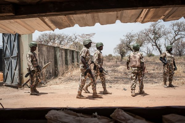 Nigerian soldiers near the school in Chibok where Boko Haram kidnapped nearly 300 girls two years ago. Most of the girls are still missing. Credit Stefan Heunis/Agence France-Presse — Getty Images