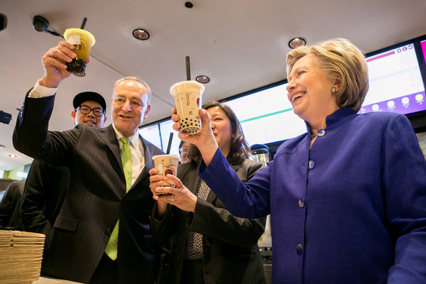 Mrs. Clinton getting bubble tea with Senator Chuck Schumer at Kung Fu Tea in Flushing, Queens, on Monday. Credit Sam Hodgson for The New York Times