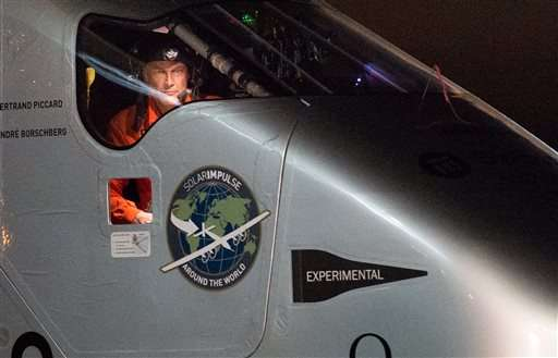Solar Impulse 2 pilot Bertrand Piccard looks out his cockpit window shortly after landing at Moffett Field in Mountain View, Calif., on Saturday, April 23, 2016. The solar-powered airplane landed in California on Saturday, completing a risky, three-day flight across the Pacific Ocean as part of its journey around the world.(AP Photo/Noah Berger)