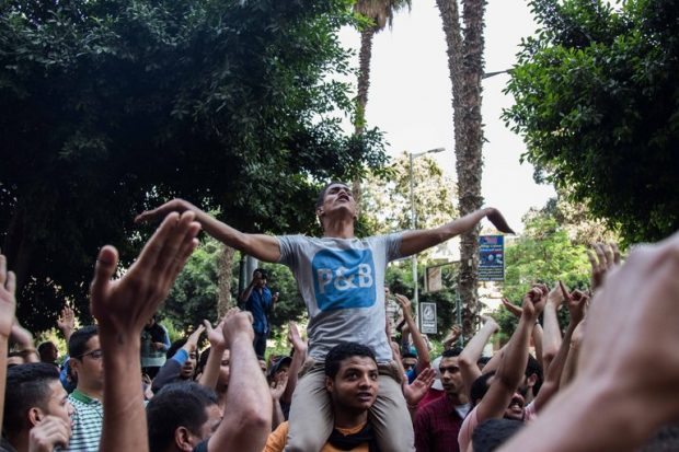 Protesters in central Cairo on Monday. Demonstrations at several prearranged meeting spots never happened and impromptu rallies were quickly dispersed. Credit Amr Abd El-Rahman/European Pressphoto Agency
