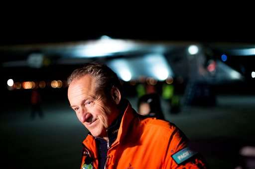 André Borschberg, co-founder of the Solar Impulse project, speaks with reporters after Bertrand Piccard landed Solar Impulse 2 at Moffett Field in Mountain View, Calif., on Saturday, April 23, 2016. The plane, which is on an around-the-world journey, arrived from Hawaii after crossing the Pacific Ocean. (AP Photo/Noah Berger)