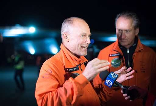 Solar Impulse 2 pilots Bertrand Piccard, left, and Andre Borschberg speak with reporters after their solar-powered plane landed at Moffett field in Mountain View, Calif., on Saturday, April 23, 2016. The solar-powered airplane landed in California on Saturday, completing a risky, three-day flight across the Pacific Ocean as part of its journey around the world. (AP Photo/Noah Bergeq