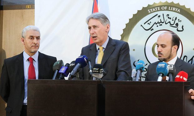 Philip Hammond, centre, discussing the threat from Isis alongside Libyan government ministers in Tripoli. Photograph: Xinhua/Barcroft Media