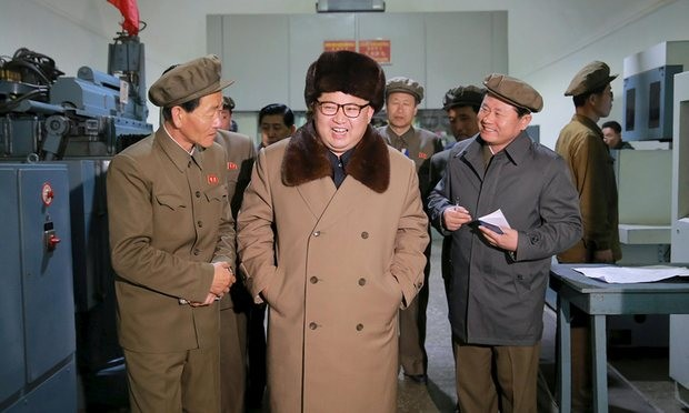 Leader Kim Jong-un smiles during a visit to the Sinhung Machine Plant in Pyongyang. Photograph: KCNA/Reuters
