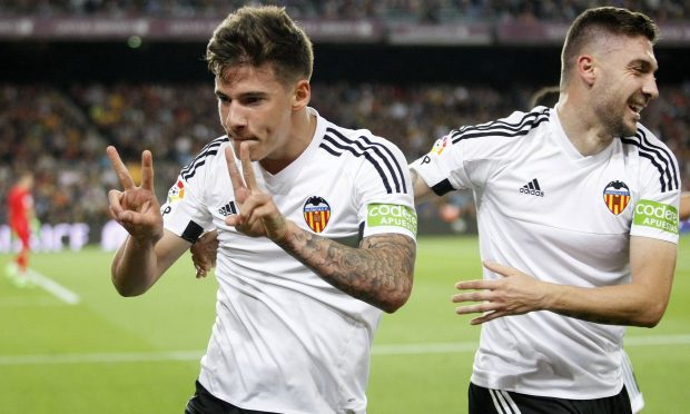 Valencia's Santi Mina celebrates scoring his side's second goal against Barcelona. Photograph: Bagu Blanco/BPI/REX/Shutterstock