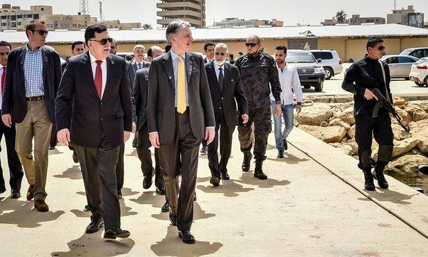 Philip Hammond (centre) tours a naval base with Libya's prime minister designate Fayez al-Sarraj on a visit to Tripoli last week. Photograph: Ben Birchall/PA