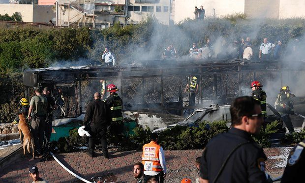 The burned-out bus following an attack in Jerusalem Photograph: Thomas Coex/AFP/Getty Images