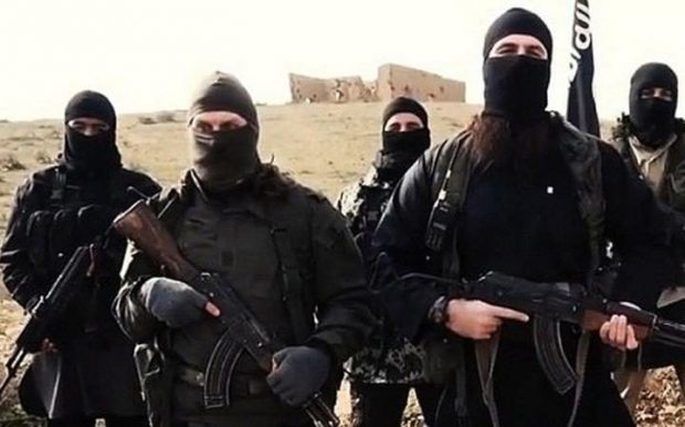 Members of ISIL in a propaganda video CREDIT: AY-COLLECTION/SIPA/REX