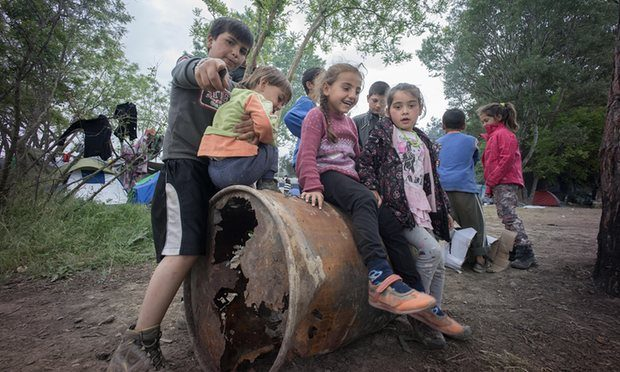 A group of refugee children seen playing at the refugee camp in Idomeni, Greece. Photograph: Geovien So/Barcroft Media