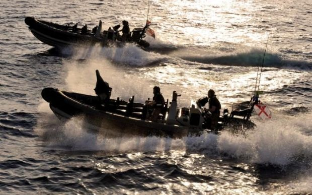 Royal Marines in the 150-strong task group have been practising boarding and searching small craft Credit: MoD