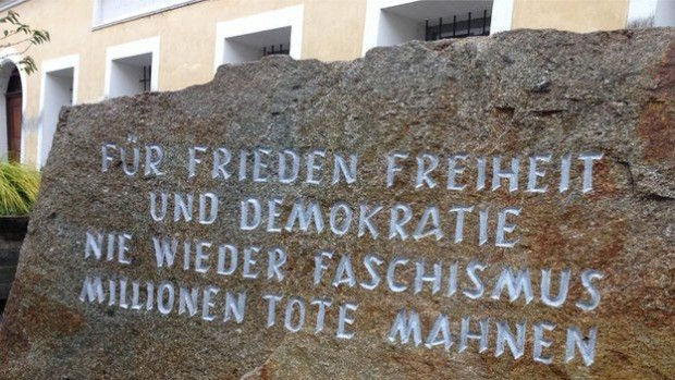 A stone plaque outside Hitler's birthplace honours the victims of fascism