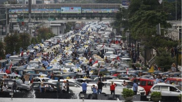 Taxis blocked roads in Jakarta in March in a protest against transport apps
