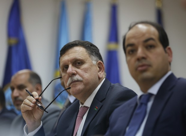 Fayez Serraj, center, head of the U.N.-backed unity government meets with his team in Tripoli, Libya, on March 31. (Mohamed Ben Khalifa/AP)