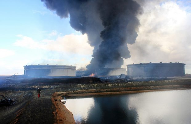 Smoke rising from an oil facility in northern Libya's Ras Lanouf region in January after it was set ablaze following fresh attacks by the Islamic State gto seize key port terminals. (STRINGER/AFP/Getty Images)
