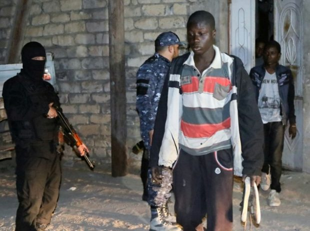 Libyan security forces detain illegal migrants reportedly trying to cross the Mediterranean to Europe, during a raid in Tripoli ©Mahmud Turkia (AFP/File)