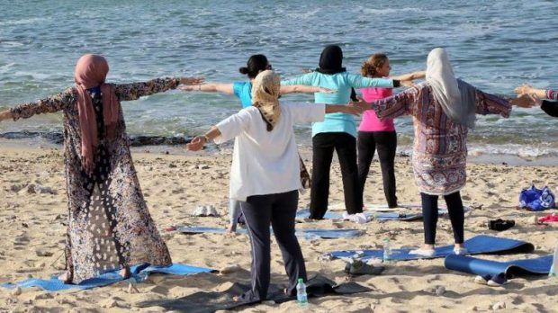 Breathing easy: women escape the realities of conflict-torn Libya at seaside yoga. (AFP)