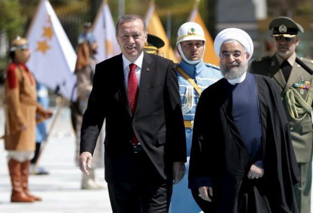 Turkish President Tayyip Erdogan (L) is seen with his Iranian counterpart Hassan Rouhani during a welcoming ceremony at the Presidential Palace in Ankara, Turkey April 16, 2016, in this handout photo provided by the Presidential Palace. REUTERS/Murat Cetinmuhurdar/Presidential Palace/Handout via Reuters