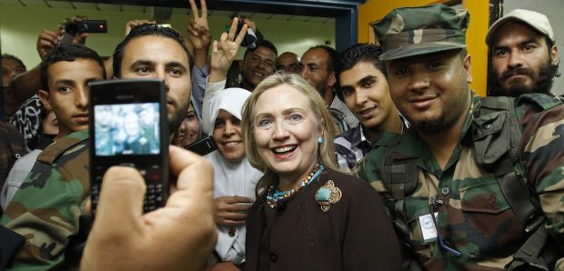 U.S. Secretary of State Hillary Clinton poses for a photo during a visit a hospital in Tripoli, the capital of Libya on October 18, 2011. AFP PHOTO/KEVIN LAMARQUE/POOL (Photo credit should read KEVIN LAMARQUE/AFP/Getty Images)