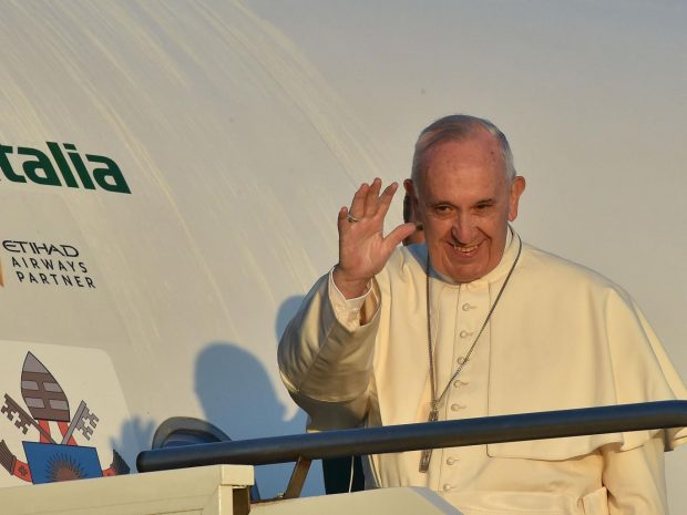Pope Francis waves to journalists as he boards an plane at Rome's Fiumicino airport, on his way to the Greek island of Lesbos AFP/Getty Images