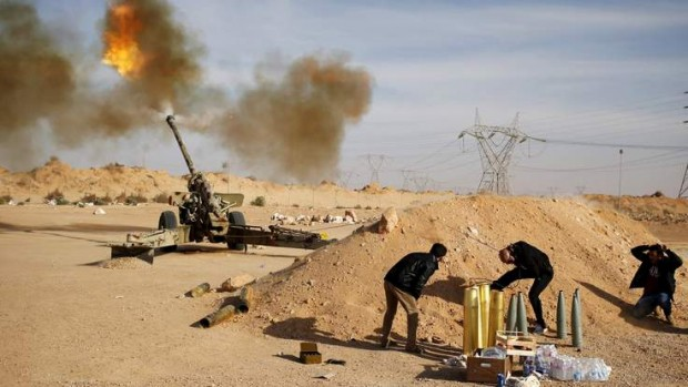 Libya Dawn fighters fire at IS militants near Sirte in 2015