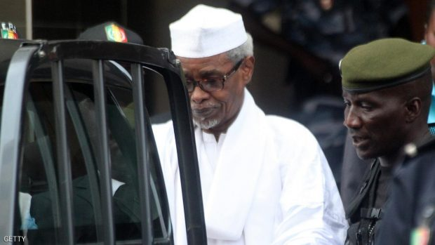 Former Chadian dictator Hissene Habre is escorted by military officers  after being heard by judge on July 2, 2013 in Dakar. Senegalese authorities charged Hissene Habre with genocide and crimes against humanity and remanded him in custody on Tuesday in a prosecution seen by many as a milestone for African justice. The 70-year-old was also charged with war crimes and torture during his eight years in power in Chad, where rights groups say 40,000 people were killed under his rule, a court source and his lawyers told AFP.   AFP PHOTO / STRINGER