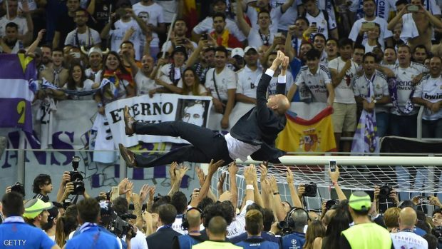 Real Madrid's French coach Zinedine Zidane is thrown into the air by Real Madrid players and staff members after they won the UEFA Champions League final football match over Atletico Madrid at San Siro Stadium in Milan, on May 28, 2016. / AFP / OLIVIER MORIN        (Photo credit should read OLIVIER MORIN/AFP/Getty Images)