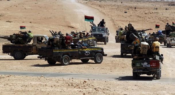 Anti-Gaddafi fighters drive towards Sirte, the hometown of deposed leader Muammar Gaddafi