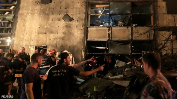 Civil defense members and policemen inspect the site of an explosion at Blom Bank in Beirut, Lebanon June 12, 2016. REUTERS/Jamal Saidi