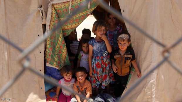 Iraqi children, whose families fled the ongoing fighting between government forces and Islamic State (IS) group jihadists in the Fallujah area, gather inside a tent at a camp for displaced people in Amriyat al-Fallujah on June 14, 2016. Iraq forces launched a vast offensive more than three weeks ago to retake Fallujah, which lies only 50 kilometres (30 miles) west of Baghdad and is one of the main bastions of the Islamic State group. SABAH ARAR/AFP/Getty Images