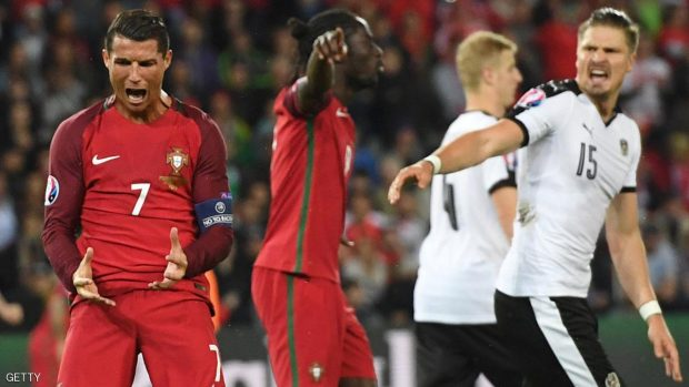 Portugal's forward Cristiano Ronaldo (L) reacts after missing an opportunity on goal during the Euro 2016 group F football match between Portugal and Austria at the Parc des Princes in Paris on June 18, 2016. FRANCISCO LEONG/AFP/Getty Images