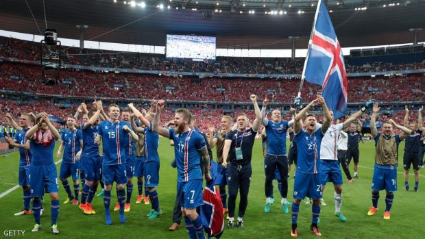 Iceland's players celebrate after the Euro 2016 group F football match between Iceland and Austria at the Stade de France stadium in Saint-Denis, near Paris on June 22, 2016. / AFP / KENZO TRIBOUILLARD        (Photo credit should read KENZO TRIBOUILLARD/AFP/Getty Images)