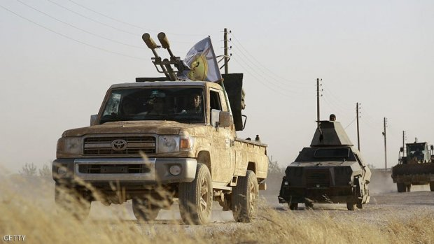 US-backed Kurdish and Arab fighters advance into the Islamic State (IS) jihadist's group bastion of Manbij, in northern Syria, on June 23, 2016.  Backed by air strikes by the US-led coalition bombing IS in Syria and Iraq, fighters with the Syrian Democratic Forces (SDF) alliance entered Manbij from the south, a monitoring group said.  / AFP / DELIL SOULEIMAN        (Photo credit should read DELIL SOULEIMAN/AFP/Getty Images)