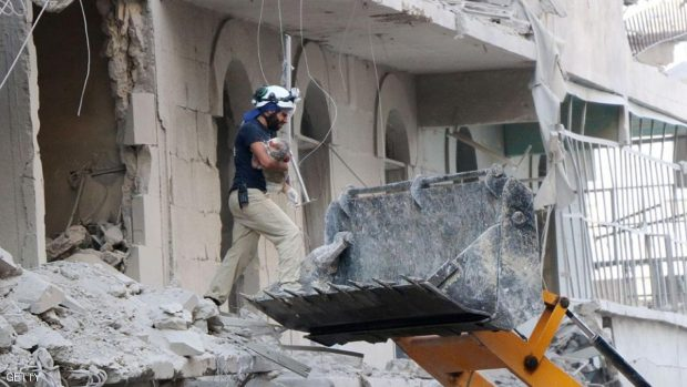 A Syrian rescue worker removes the body of a baby from the rubble of a damaged building following reported air strikes on July 7, 2016, in Aleppo's rebel-held neighbourhood of Tariq al-Bab. The Syrian army advanced within firing range of the rebels' sole supply route to Aleppo in heavy fighting despite its announcement of a ceasefire for the Eid al-Fitr holiday. Regime bombardment of several opposition-controlled districts left 10 civilians dead, including three children, the Syrian Observatory for Human Rights said. / AFP / THAER MOHAMMED        (Photo credit should read THAER MOHAMMED/AFP/Getty Images)