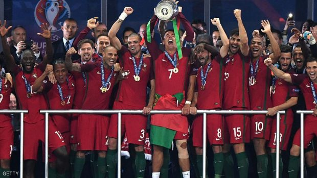 PARIS, FRANCE - JULY 10:  Cristiano Ronaldo of Portugal (c) lifts the European Championship trophy after his side win 1-0 against France during the UEFA EURO 2016 Final match between Portugal and France at Stade de France on July 10, 2016 in Paris, France.  (Photo by Michael Regan/Getty Images)