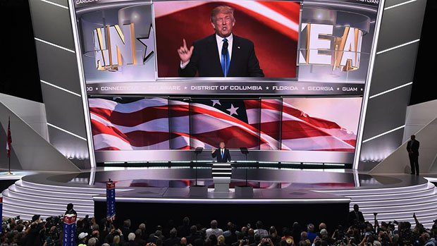 Presumptive Republican presidential candidate Donald Trump introduces his wife Melania Trump (out of frame) to delegates on the first day of the Republican National Convention on July 18, 2016 at Quicken Loans Arena in Cleveland, Ohio. The Republican Party opened its national convention, kicking off a four-day political jamboree that will anoint billionaire Donald Trump as its presidential nominee.  / AFP / Robyn BECK        (Photo credit should read ROBYN BECK/AFP/Getty Images)