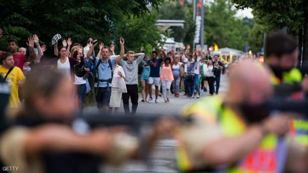 Police escorts evacuated people from the shopping mall (the Olympia Einkaufzentrum (OEZ) in Munich on July 22, 2016 following a shootings earlier. At least one person has been killed and 10 wounded in a shooting at a shopping centre in Munich on Friday, German police said. / AFP / STR        (Photo credit should read STR/AFP/Getty Images)