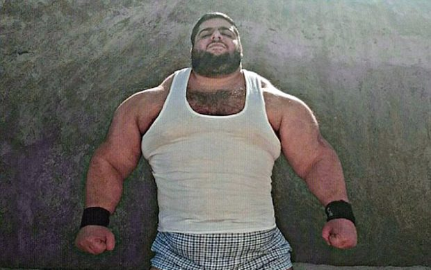Persian Hulk: The young man's muscles can barely be contained inside his white vest and he is on his way to Syria to fight ISIS