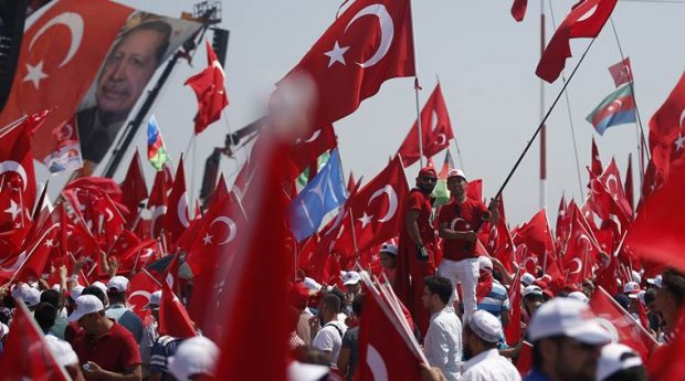 Thousands of people attend a Democracy and Martyrs' Rally in Istanbul, Sunday, Aug. 7, 2016. Crowds are gathering in Istanbul for a massive rally to mark the end of nightly democracy demonstrations following Turkey's abortive July 15 coup that killed over 270 people. (AP Photo/Emrah Gurel)