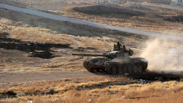 """Opposition fighters drive a tank in the Al-Huweiz area on southern outskirts of Aleppo as they battle to break the government seige on the northen Syrian city on August 2, 2016.  The Syrian regime's key ally Russia launched heavy air strikes overnight on the outskirts of divided Aleppo city, slowing a """"last-chance"""" assault by rebels seeking to break a government siege.  / AFP / Omar haj kadour        (Photo credit should read OMAR HAJ KADOUR/AFP/Getty Images)"""