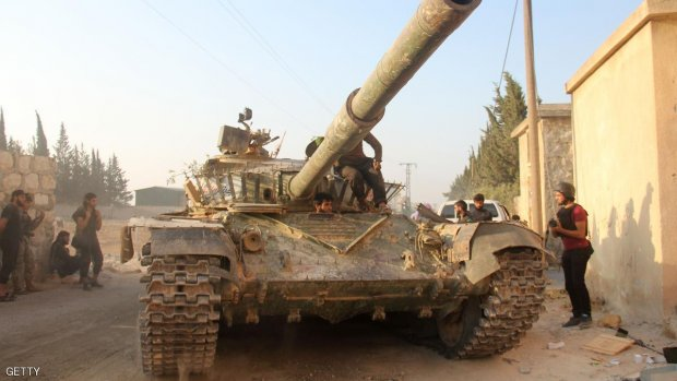 Fighters from the former Al-Nusra Front -- renamed Fateh al-Sham Front after breaking from Al-Qaeda -- drive a tank as they seized key positions south of Aleppo on August 6, 2016 in a major offensive to break the government siege of the city, the Syrian Observatory for Human Rights said.  Fateh al-Sham Front announced having captured two military academies and a third military position.  / AFP / Omar haj kadour        (Photo credit should read OMAR HAJ KADOUR/AFP/Getty Images)