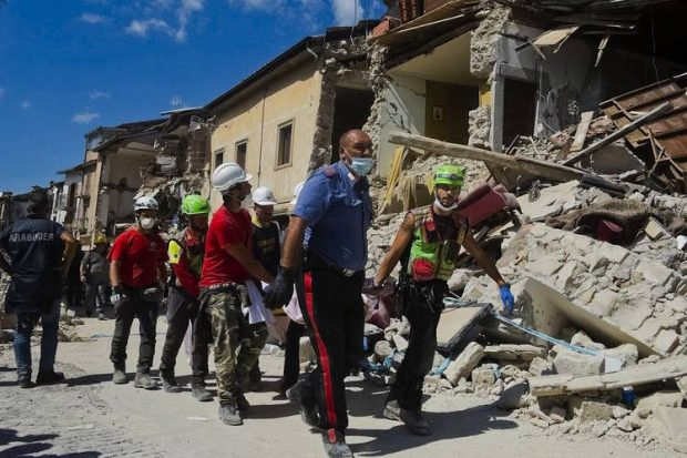 A victim is taken away in Amatrice in central Italy, where a 6.2-magnitude earthquake struck early Wednesday. Photo: Associated Press