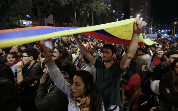 People celebrate the announcement Wednesday from Havana, Cuba, that delegates of Colombia's government and leaders of the Revolutionary Armed Forces of Colombia reached a peace accord to end their half-century civil war Colombia. Photo: Fernando Vergara / Associated Press