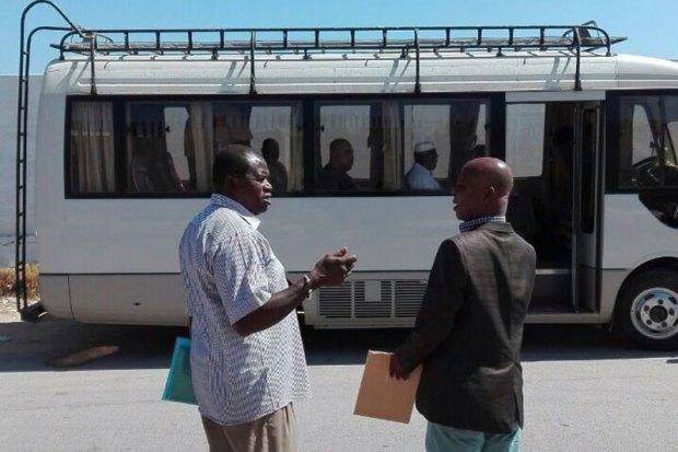 An IOM bus takes embassy representatives to the detention center. Photo: IOM