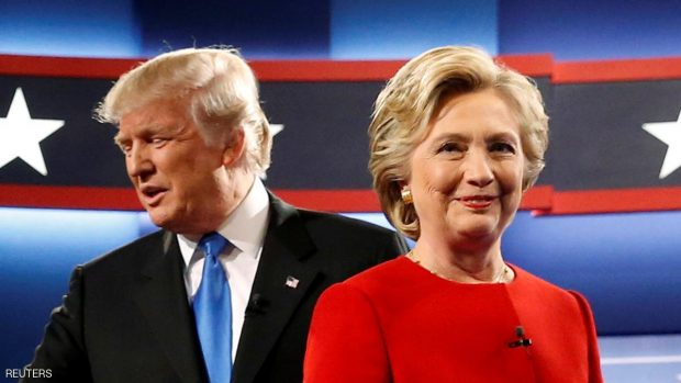 Republican U.S. presidential nominee Donald Trump and Democratic U.S. presidential nominee Hillary Clinton greet one another as they take the stage for their first debate at Hofstra University in Hempstead, New York, U.S. September 26, 2016. REUTERS/Jonathan Ernst