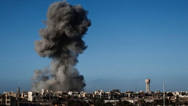 Sept. 28, 2016: Smoke rises after an airstrike on an ISIS-held area of Sirte, Libya.  (AP Photo/Manu Brabo