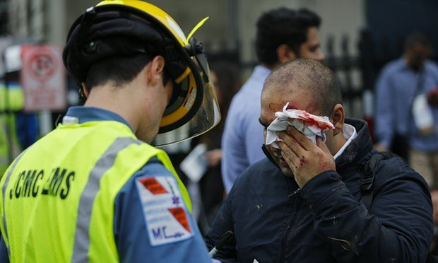 People are treated for their injuries outside after a NJ Transit train crashed in to the platform at Hoboken terminal. Photograph: Eduardo Munoz Alvarez/Getty Images