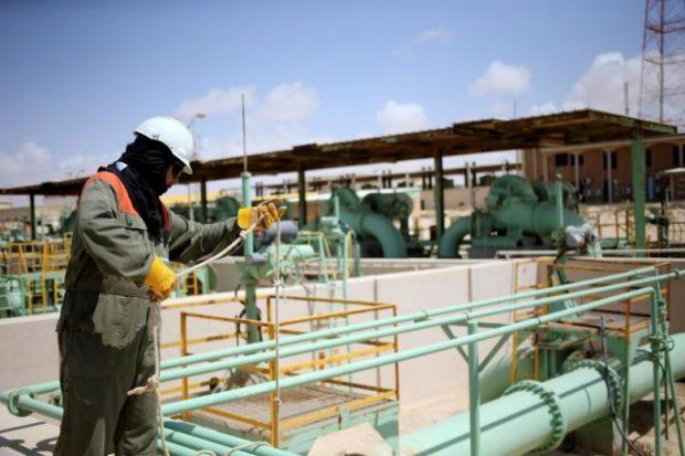 A worker maintains oil pipelines at the Zueitina oil terminal in Zueitina. REUTERS/Esam Omran Al-Fetori