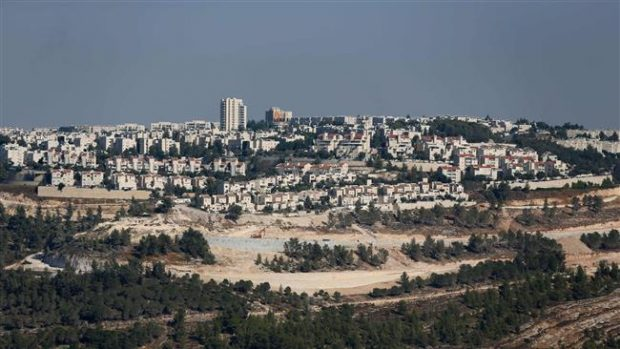 This picture taken on July 29, 2016 shows a general view of Israeli construction cranes and excavators at the building site of new units in the illegal settlement of Gilo in occupied East Jerusalem al-Quds. ©AFP